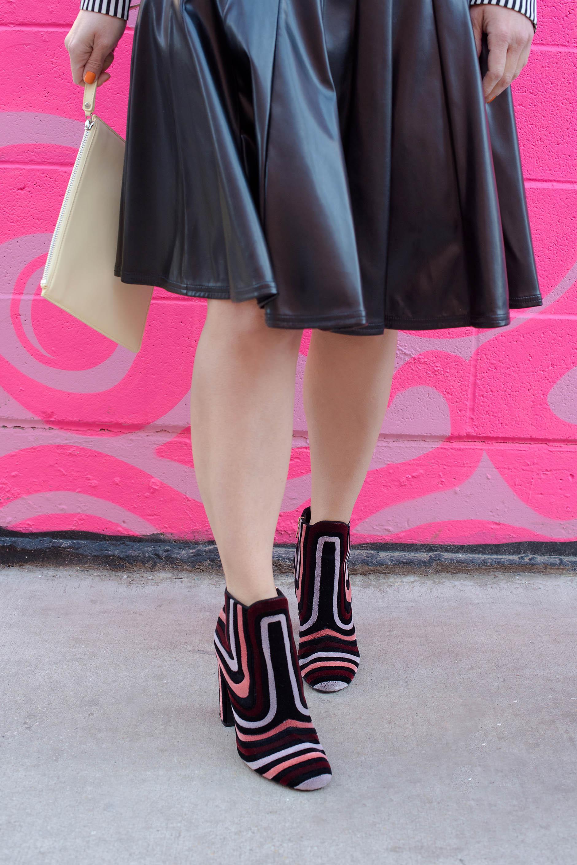 Anna Roufos Sosa of Noir Friday wearing Christopher Kane clutch and Salvatore Ferragamo boots.