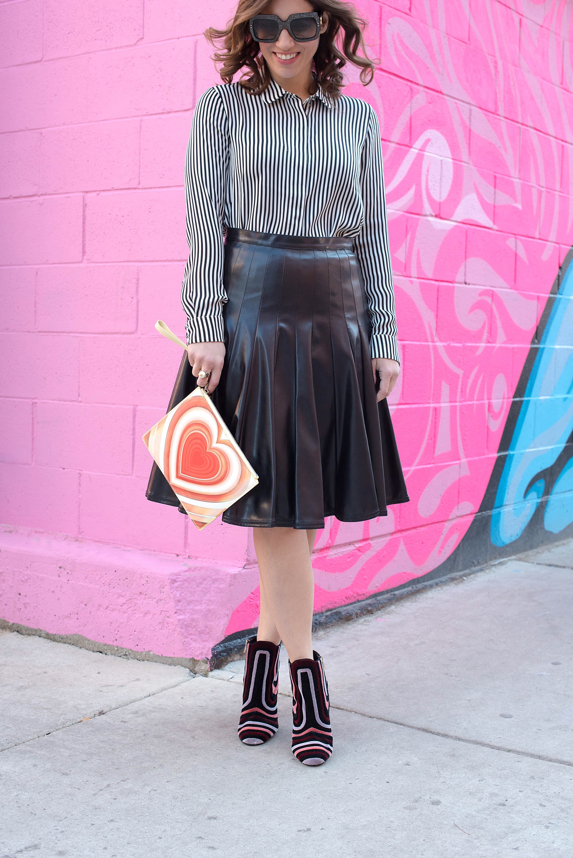 Anna Roufos Sosa of Noir Friday wearing Christopher Kane clutch and Salvatore Ferragamo boots.