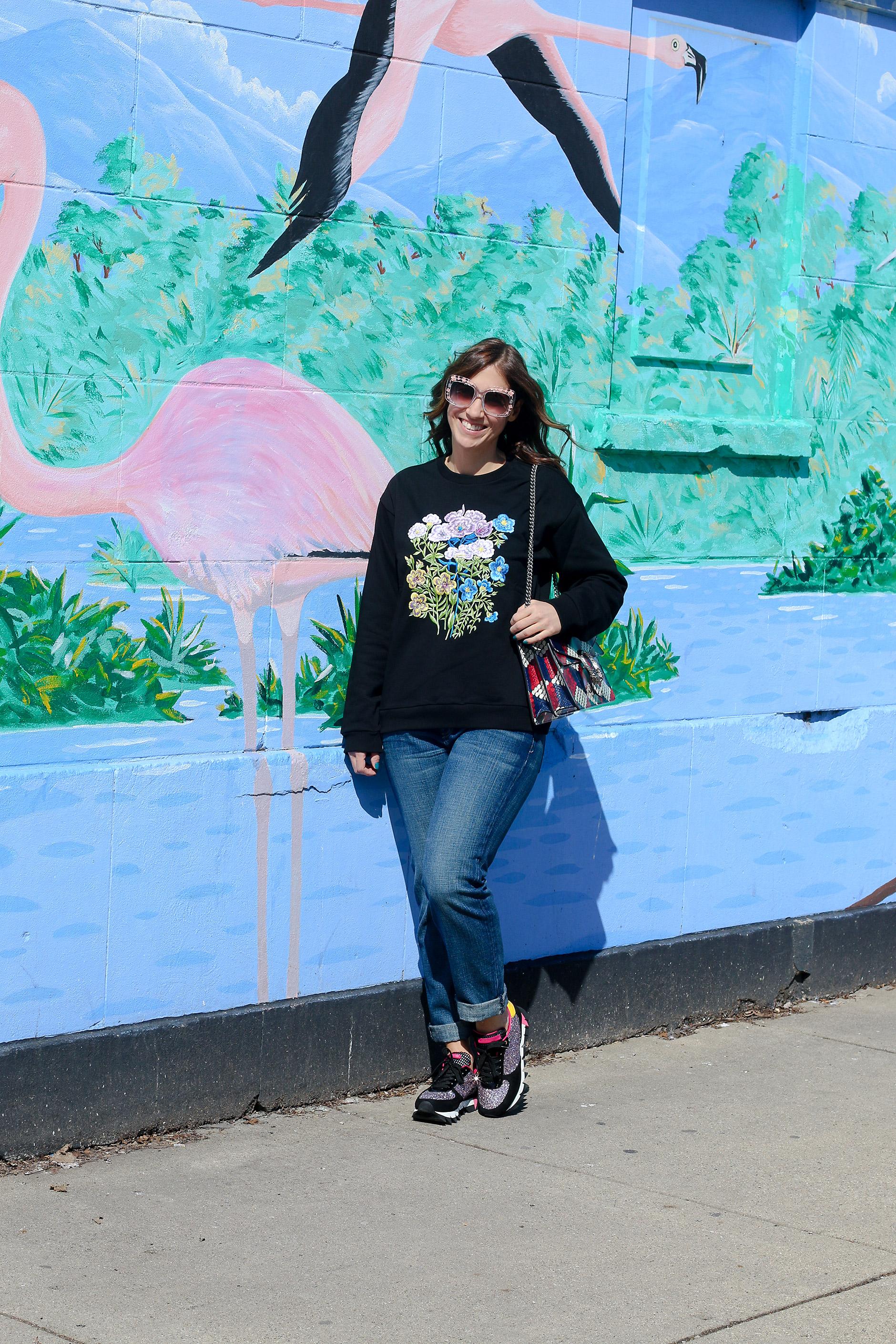 Anna Roufos Sosa of Noir Friday wearing a Christopher Kane sweatshirt and Dolce & Gabbana sneakers.