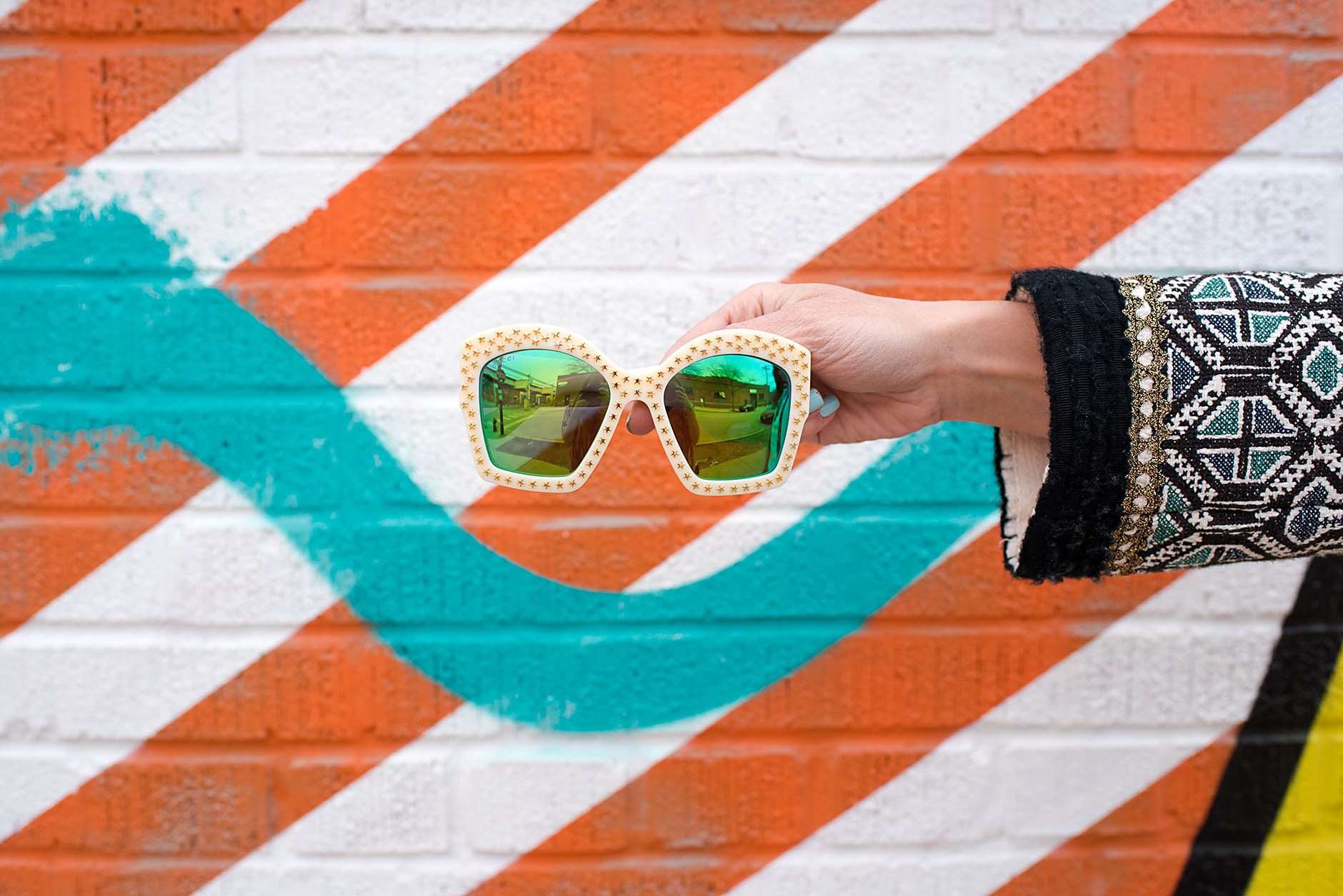 Anna Roufos Sosa of Noir Friday featuring Gucci sunglasses found on sale at MatchesFashion.com.