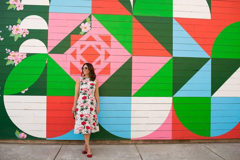 Anna Roufos Sosa of Noir Friday wearing an Erdem carnation print dress and Gucci pumps.