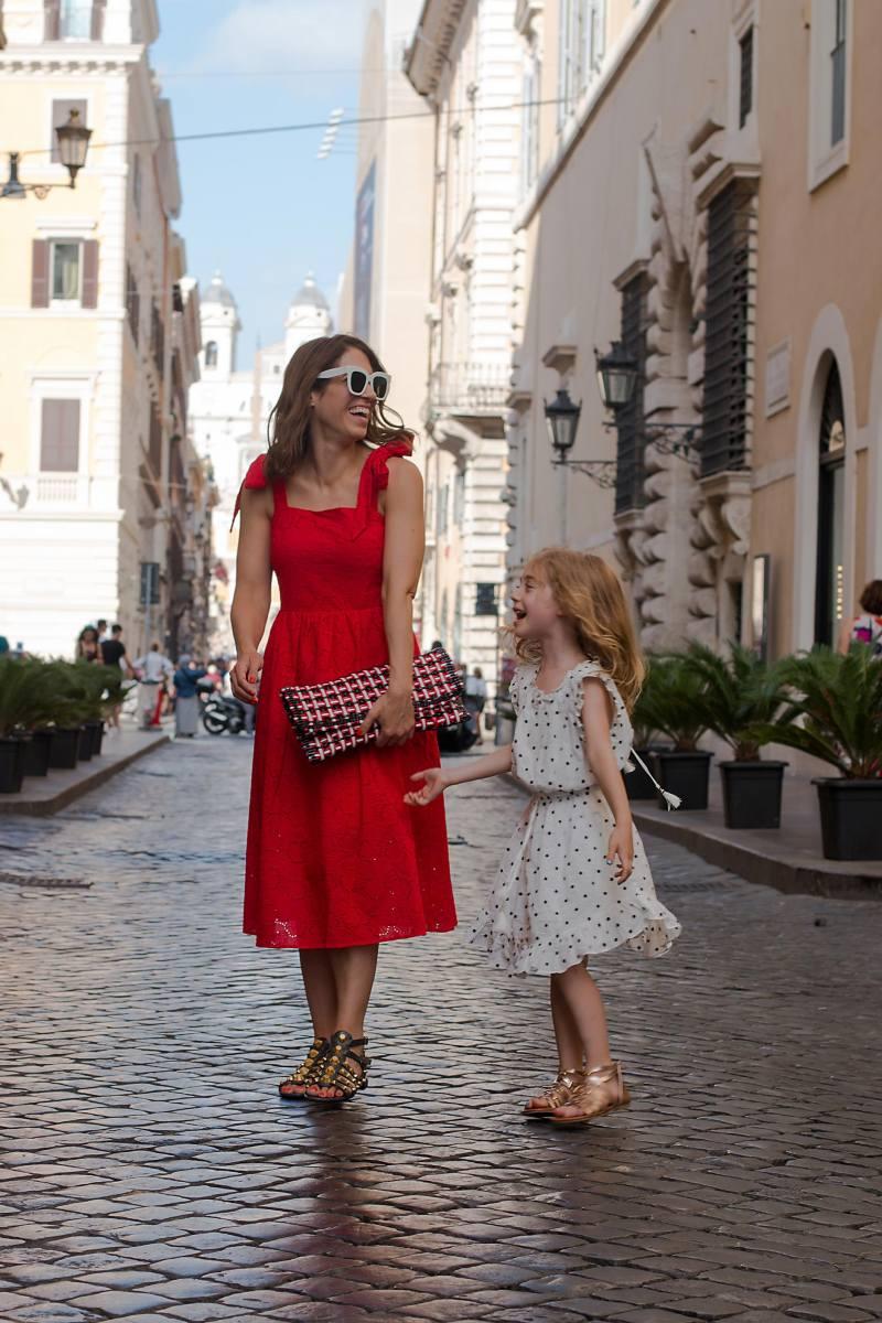 Anna Roufos Sosa of Noir Friday wearing an H&M eyelet dress and Balenciaga clutch and sandals.