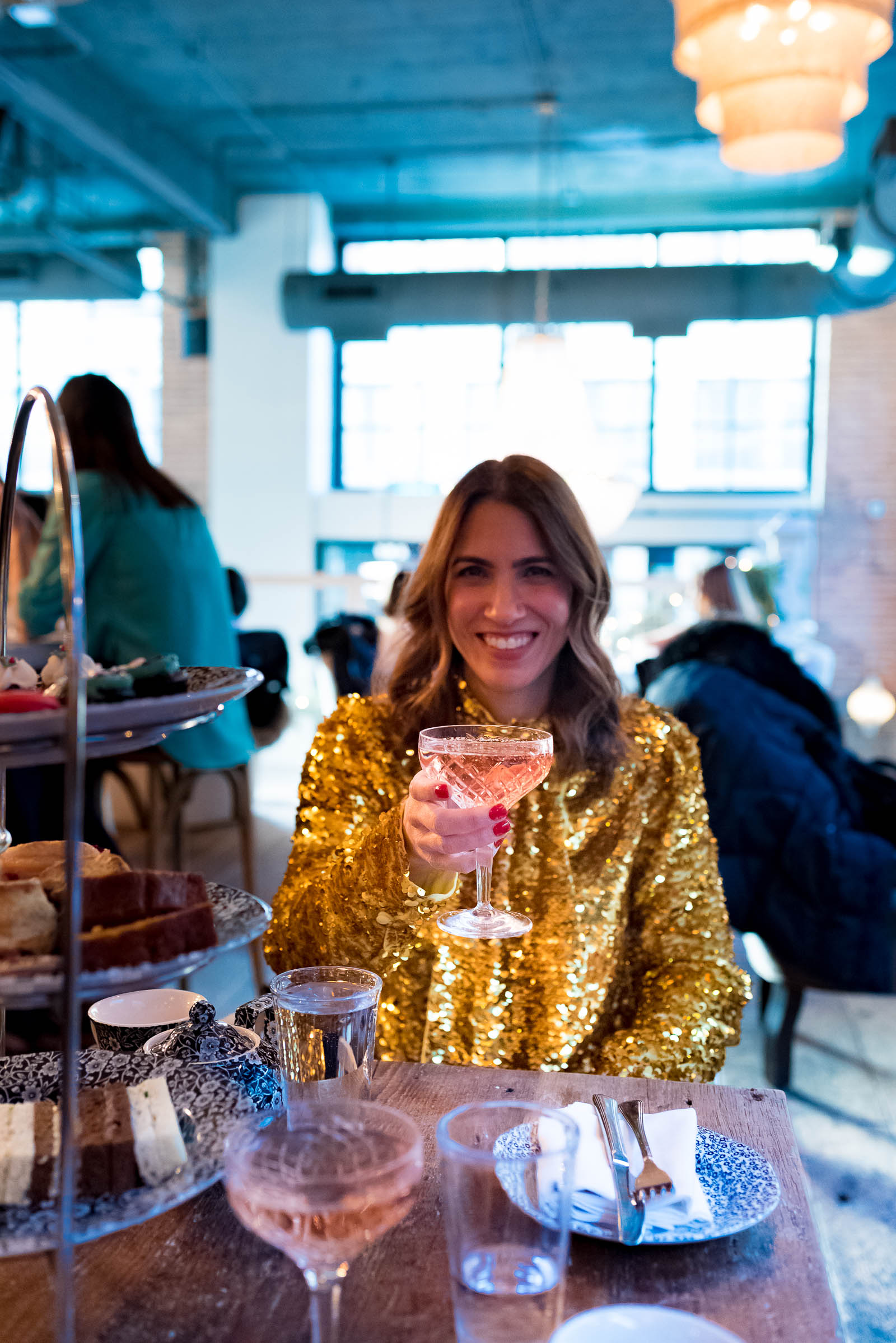 Anna Roufos Sosa of Noir Friday having the holiday afternoon tae at Soho House Chicago in a MSGM top.