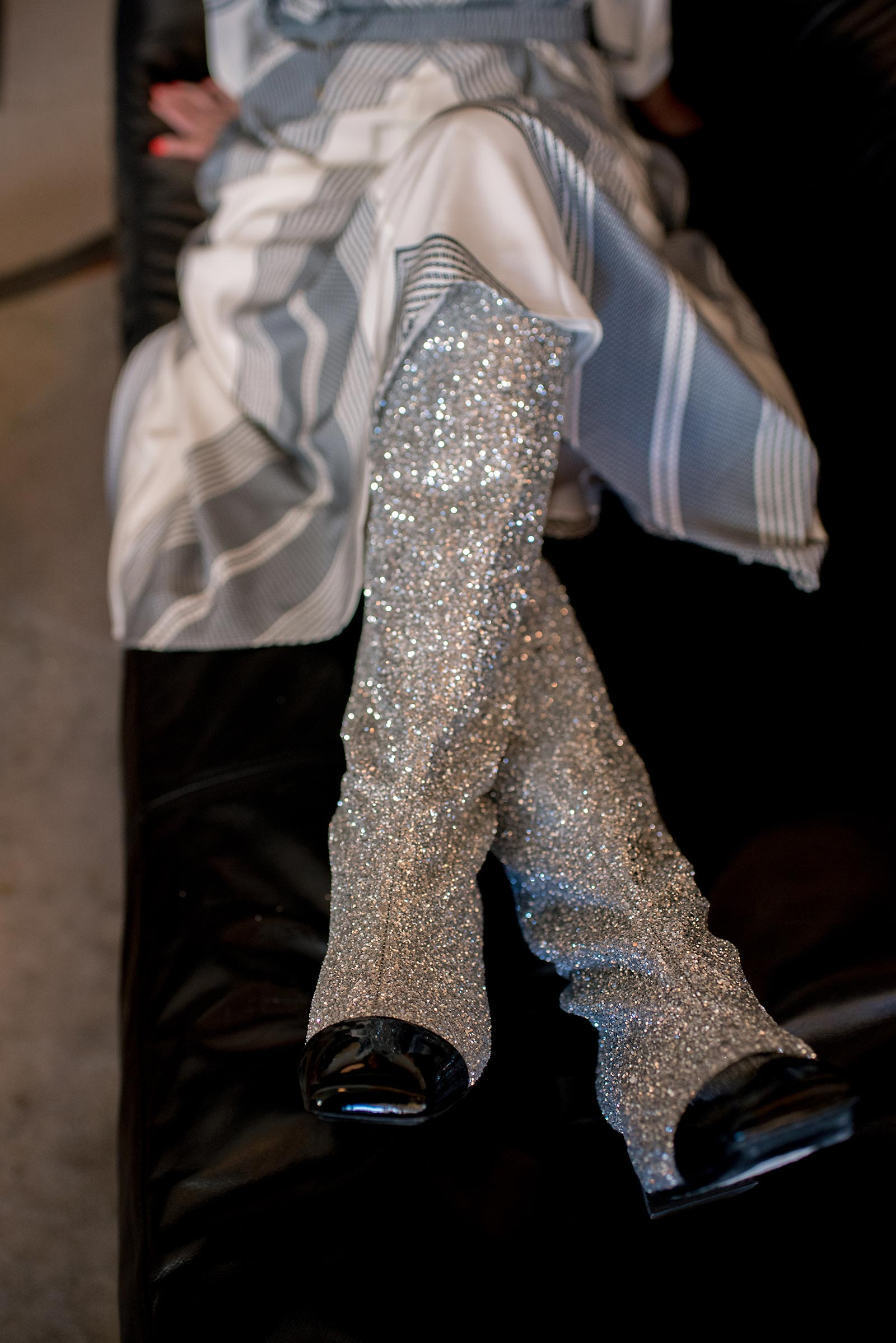 Anna Roufos Sosa of Noir Friday in the Chanel glitter boots.