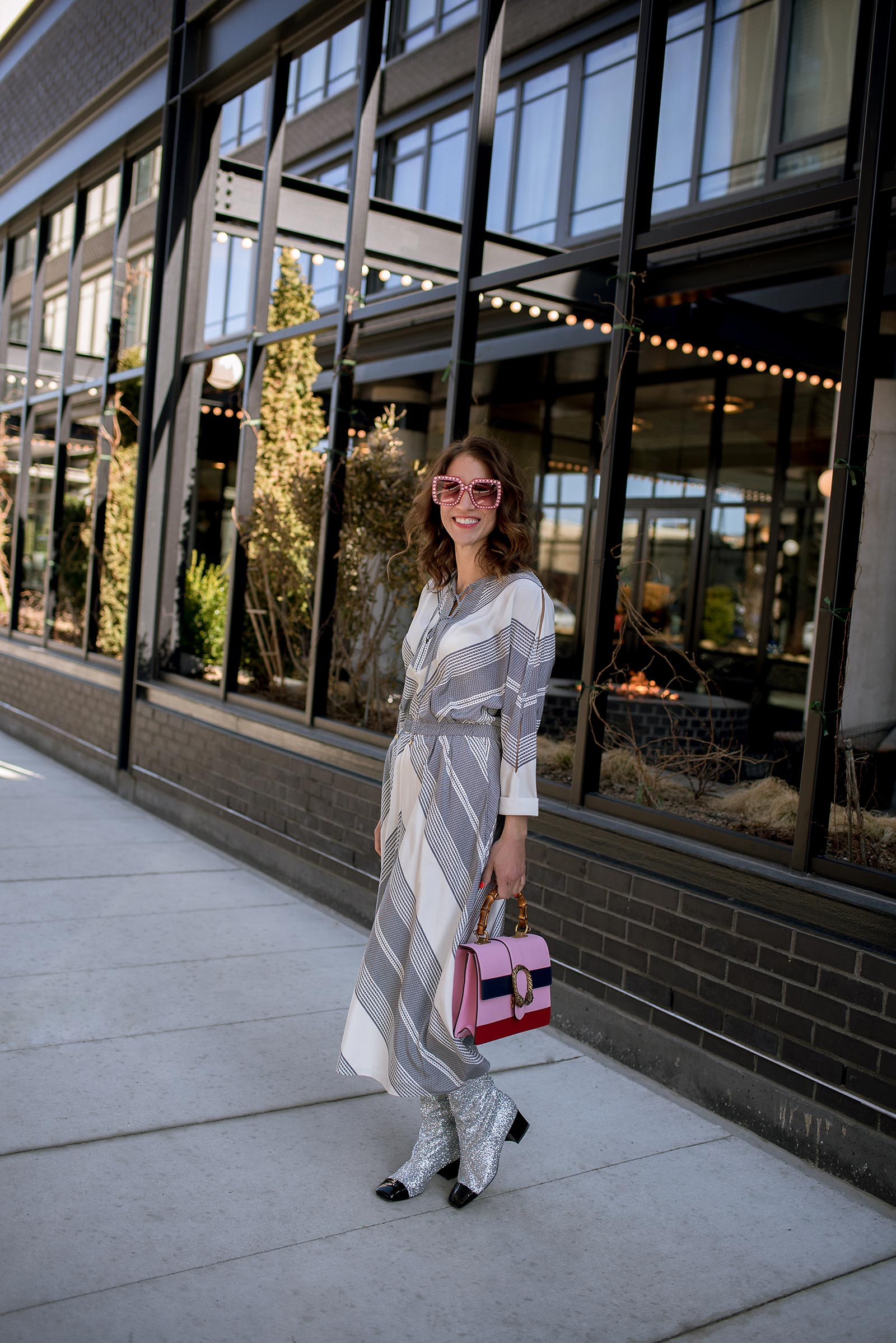 Anna Roufos Sosa of Noir Friday wearing a 10 Crosby Derek Lam dress, Chanel boots and a Gucci bag.