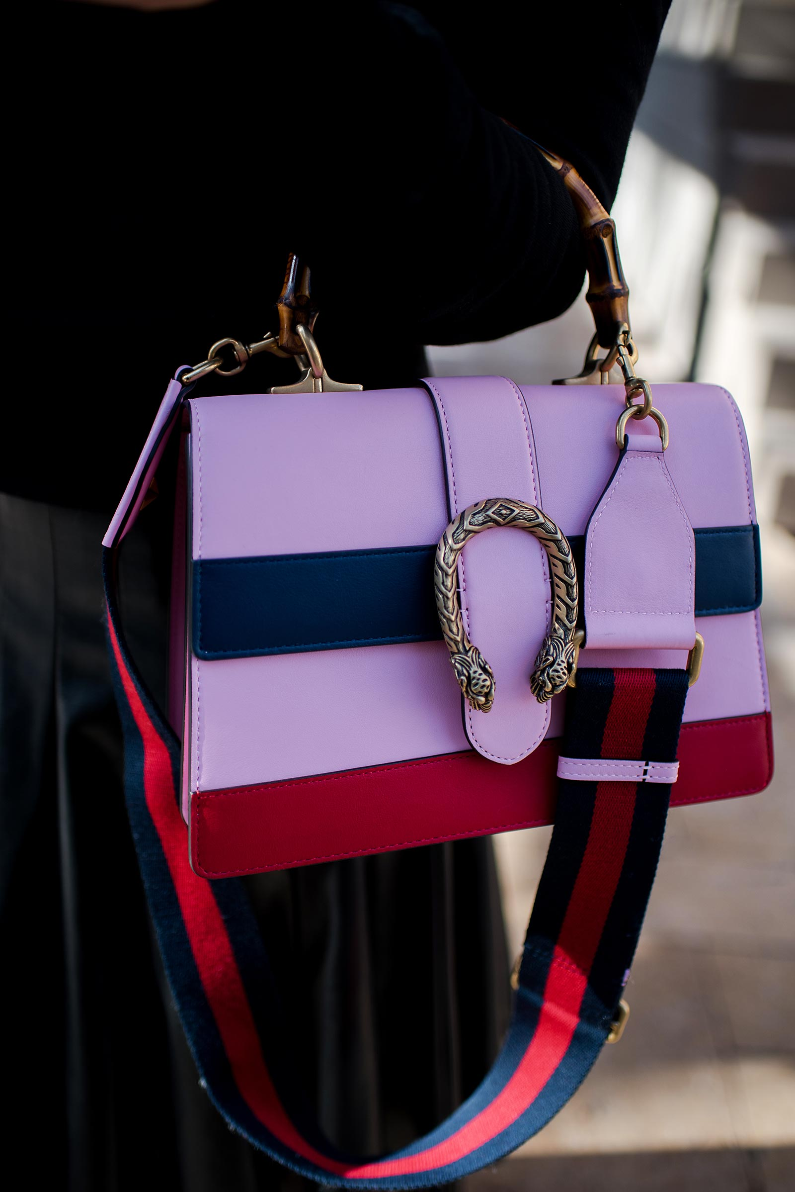 Anna Roufos Sosa of Noir Friday wearing the Olympia Le-Tan smoking lips beaded sweatshirt and a Gucci bag.