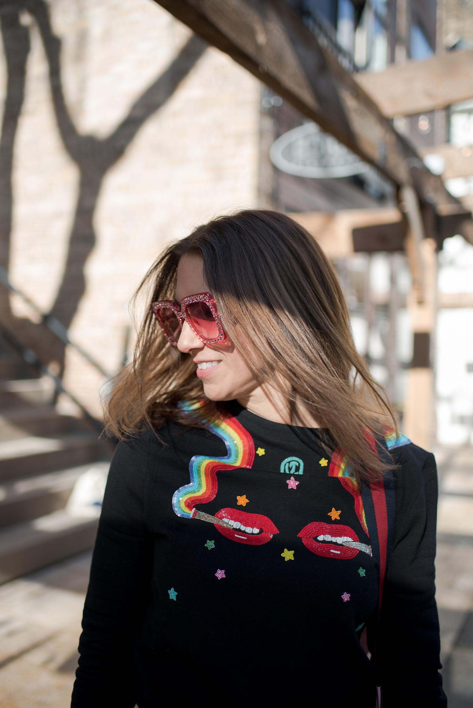 Anna Roufos Sosa of Noir Friday wearing the Olympia Le-Tan smoking lips beaded sweatshirt.
