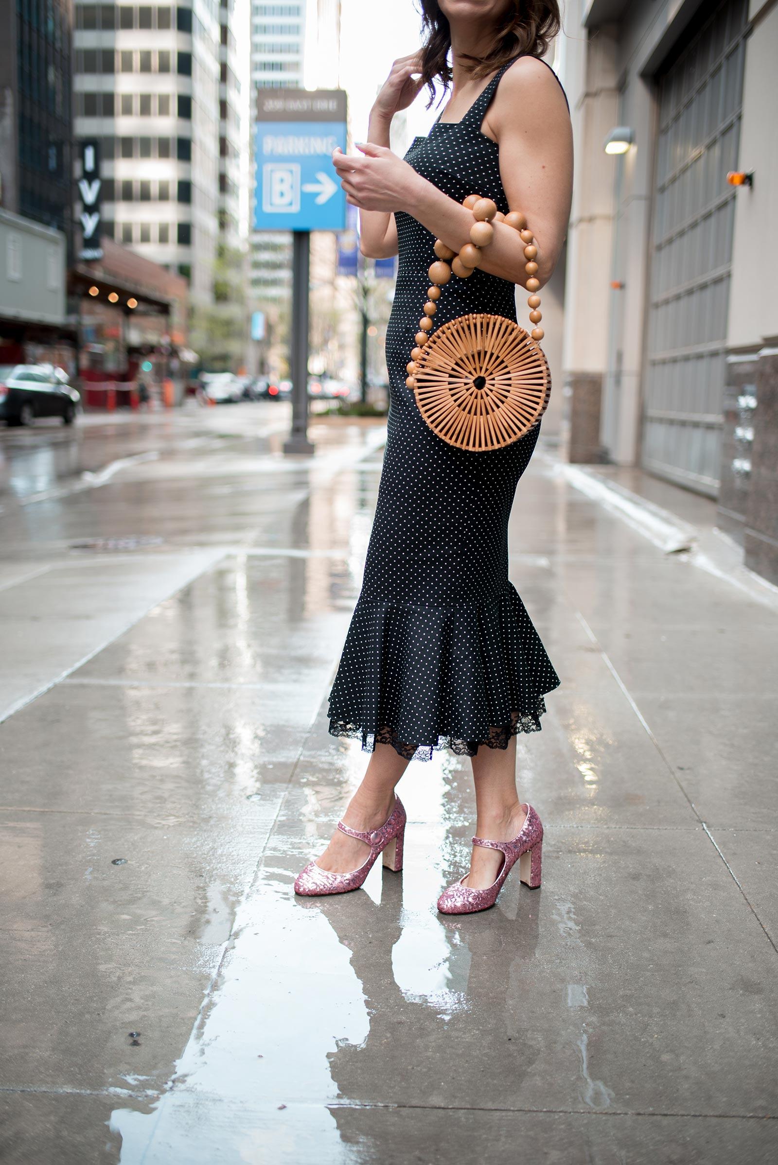Anna Roufos Sosa of Noir Friday wearing a Dolce & Gabbana polka dot dress and a Cult Gaia bag.