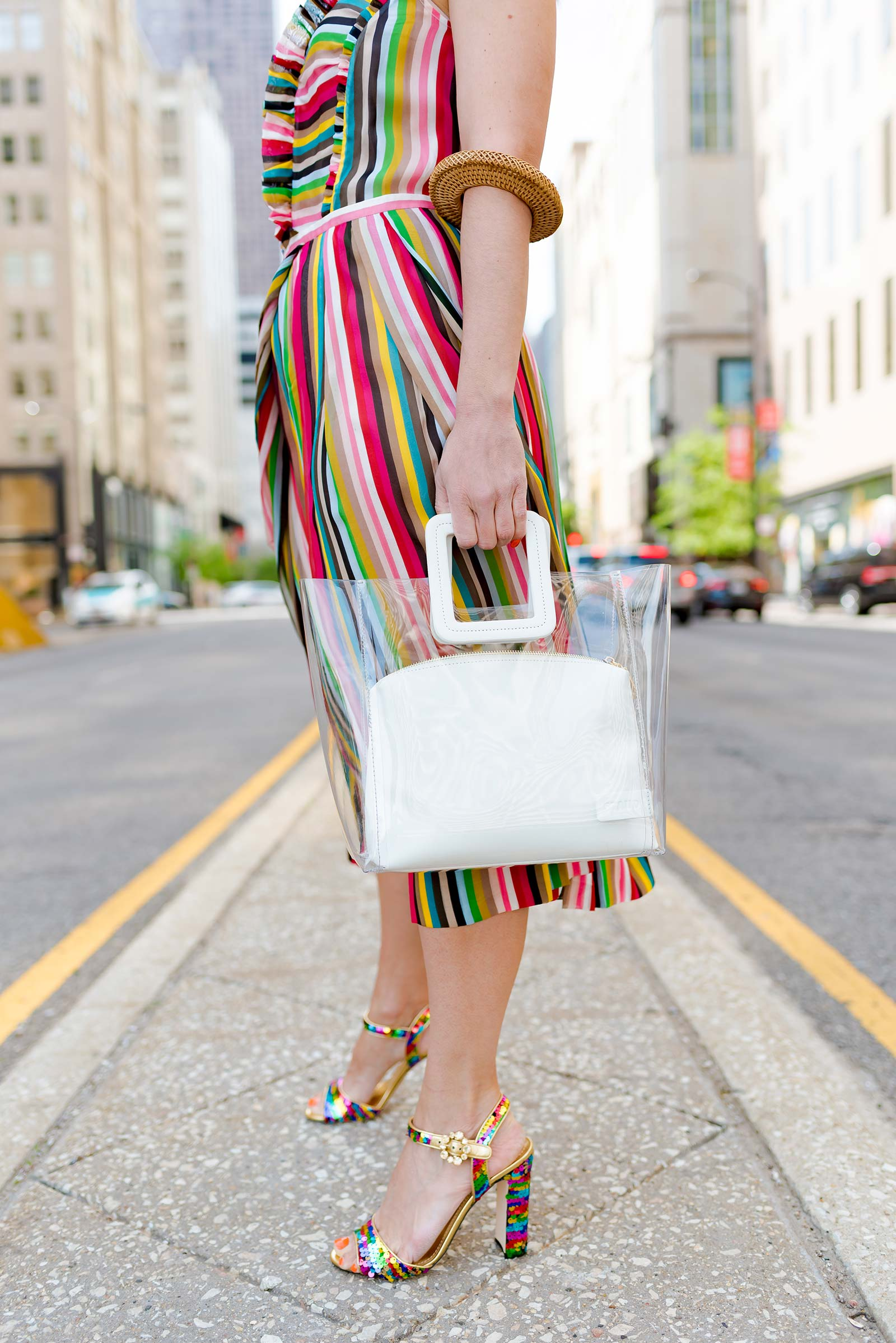 Anna Roufos Sosa of Noir Friday wearing a No. 21 dress, Dolce & Gabbana sandals and a Staud bag.