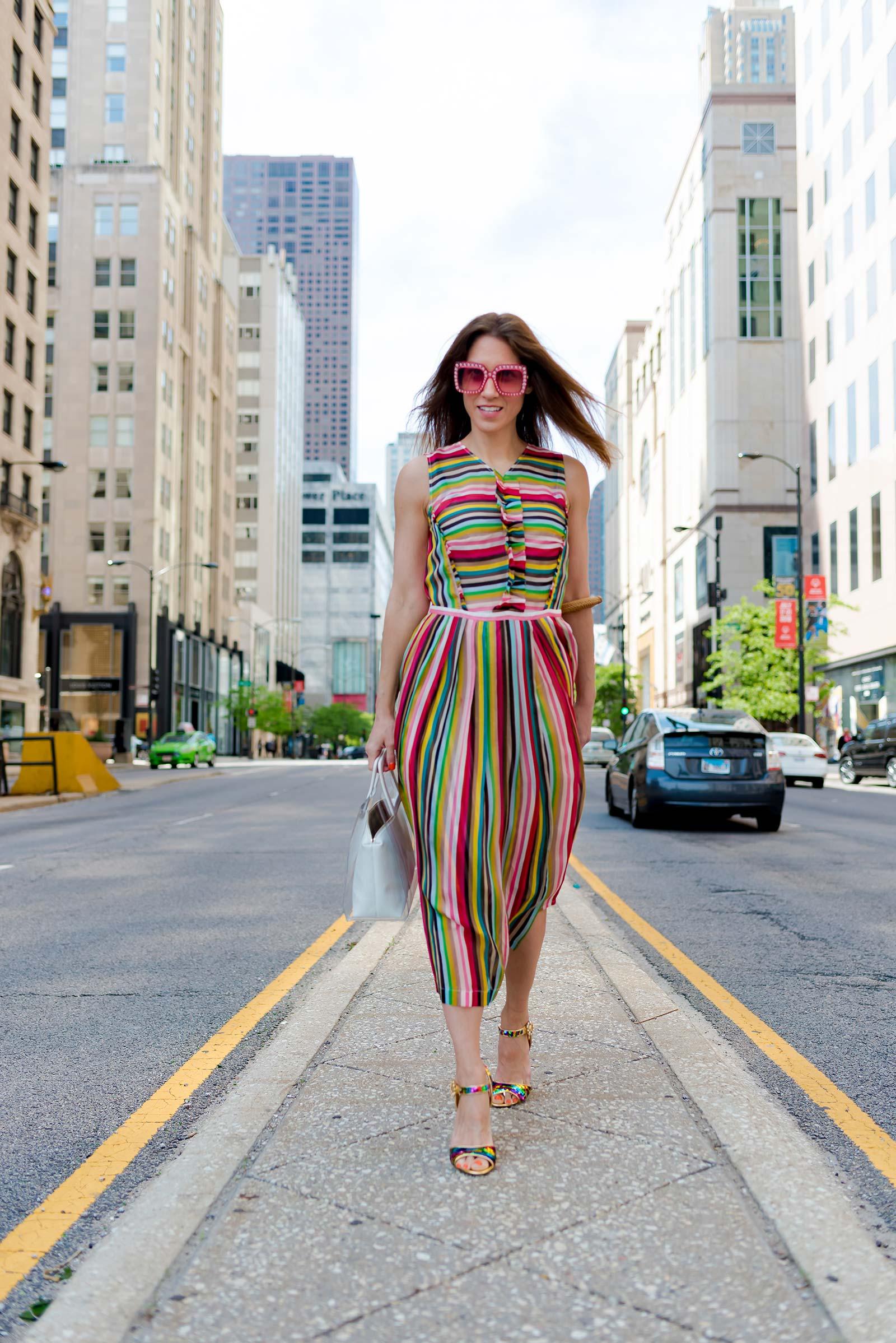 Anna Roufos Sosa of Noir Friday wearing a No. 21 dress, Dolce & Gabbana sandals and a Staud bag.