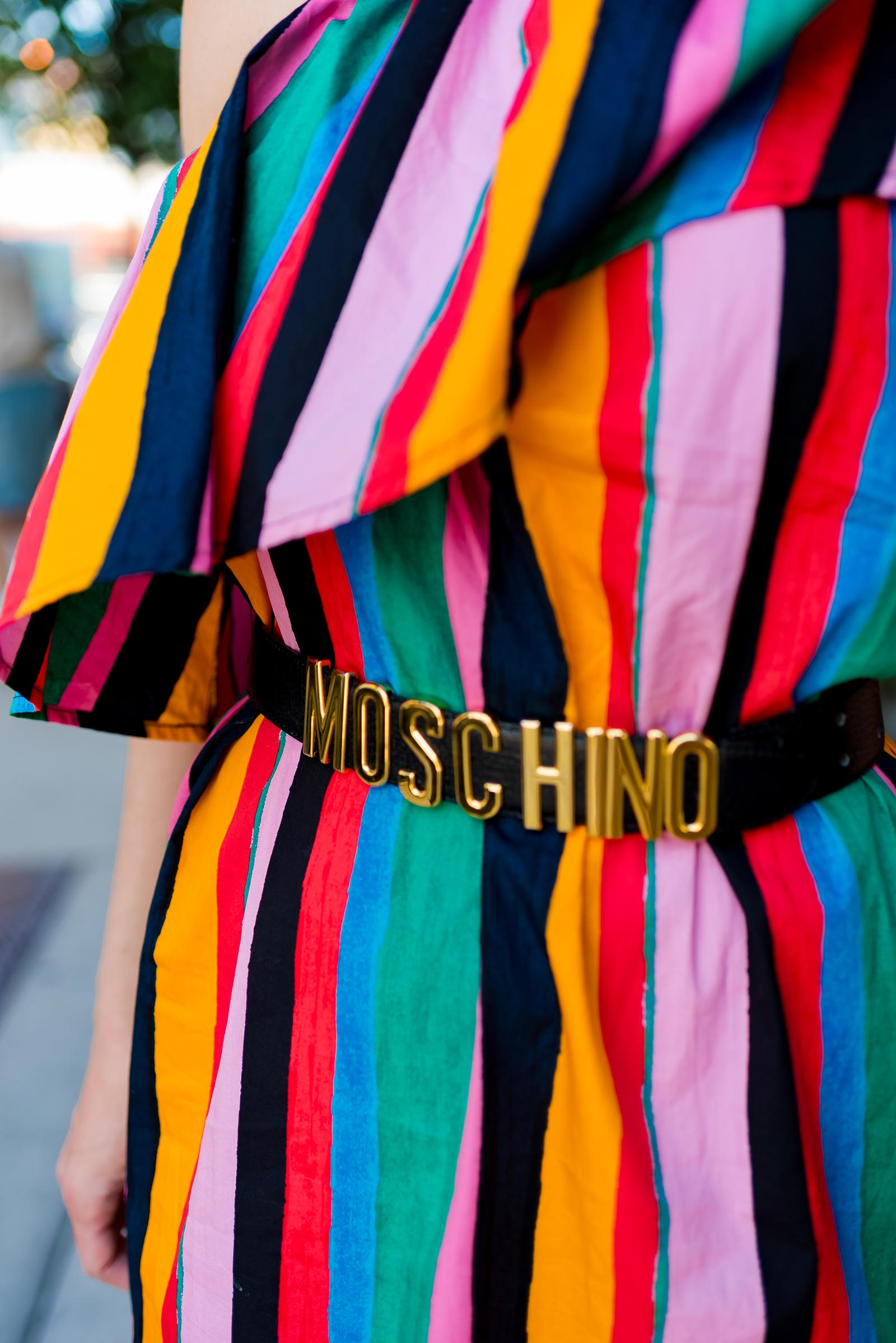 Anna Roufos Sosa of Noir Friday wearing a Who What Wear dress and Moschino belt.