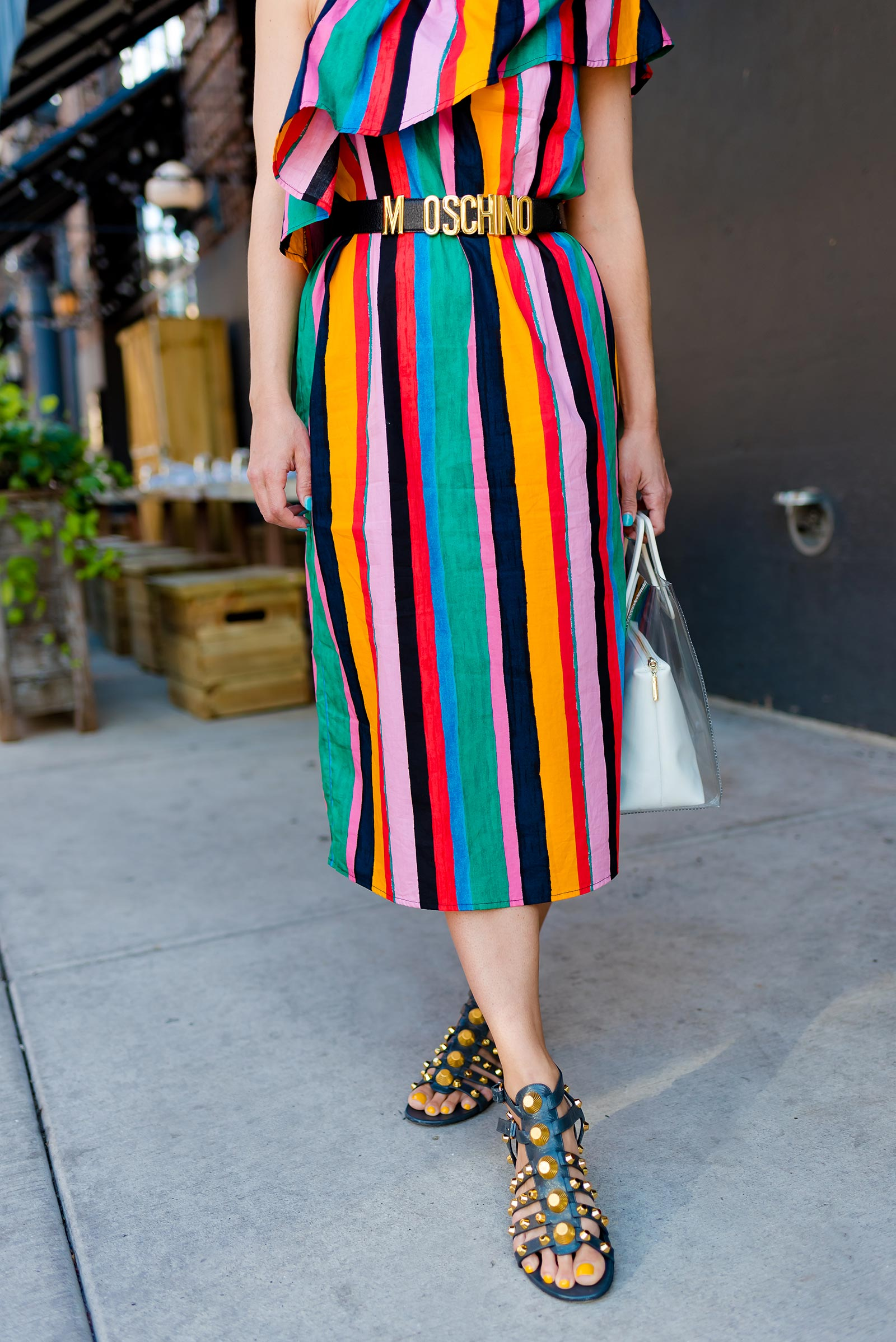Anna Roufos Sosa of Noir Friday wearing a Who What Wear dress and Staud bag.