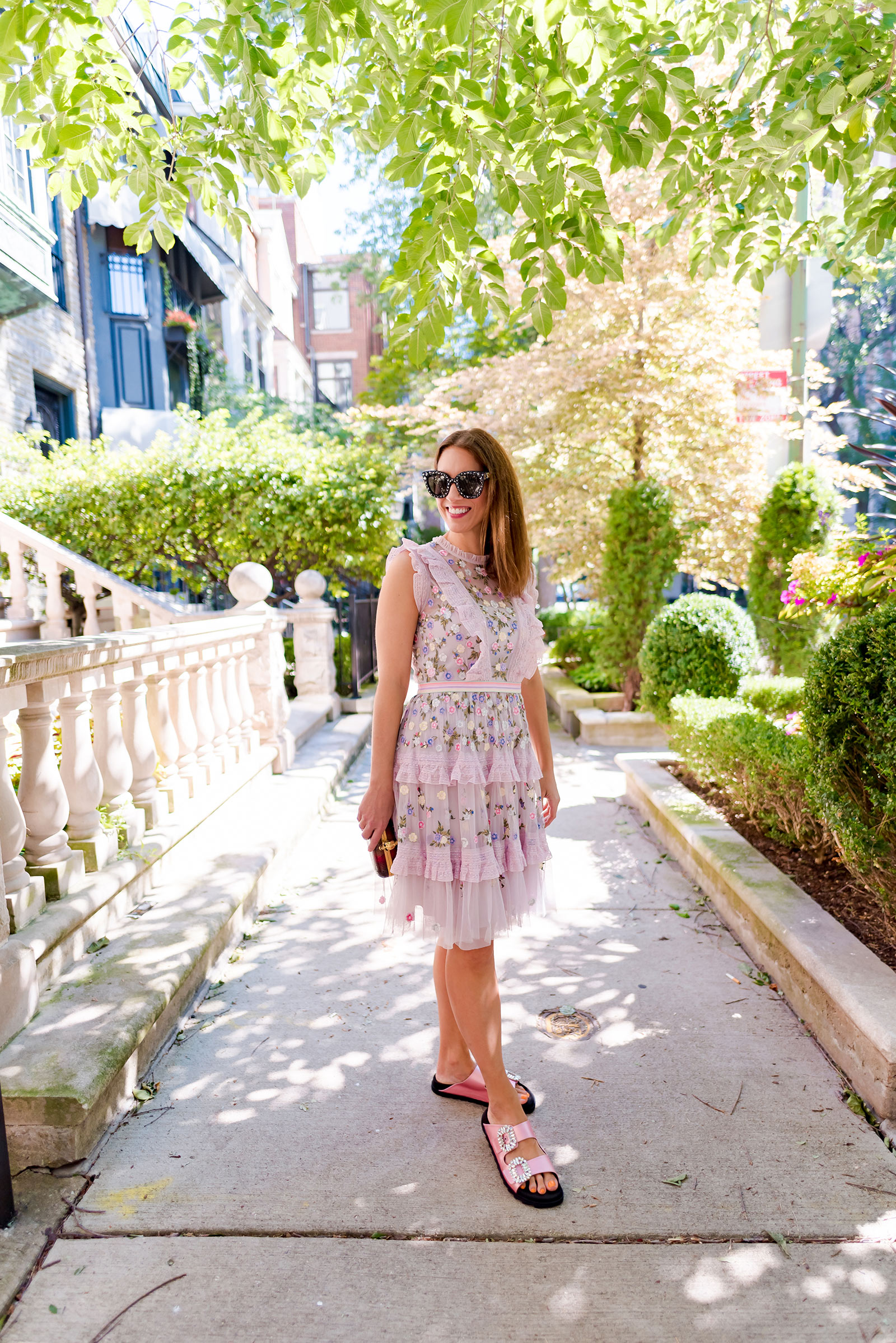 Anna Roufos Sosa of Noir Friday in a Needle & Thread dress and Roger Vivier sandals.